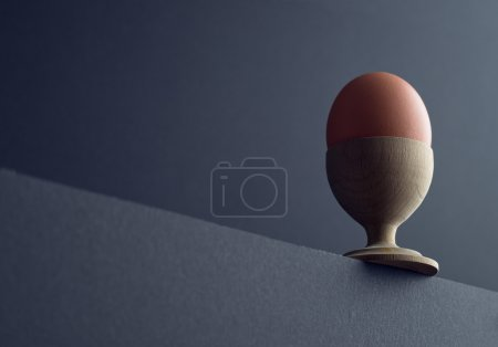 Brown egg in egg cup